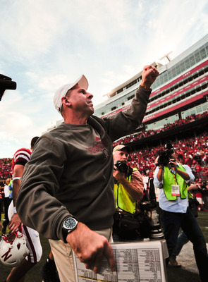 LINCOLN, NE - OCTOBER 30: Coach Bo Pelini of the Nebraska Cornhuskers pumps his fist to the Husker faithful after their game against the Missouri Tigers at Memorial Stadium on October 30, 2010 in Lincoln, Nebraska. Nebraska Defeated Missouri 31-17. (Photo