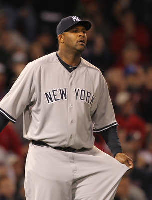 BOSTON, MA - APRIL 10:  CC Sabathia #52 of the New York Yankees reacts during a game against the Boston Red Sox at Fenway Park April 10, 2011 in Boston, Massachusetts. (Photo by Jim Rogash/Getty Images)