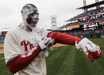PHILADELPHIA, PA - APRIL 01:  John Mayberry Jr. #14 of the Philadelphia Phillies smiles after getting hit with a cream pie after driving in the game winning run to defeat the Houston Astros 5-4 on opening day at Citizens Bank Park on April 1, 2011 in Phil