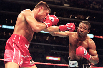 LOS ANGELES - JUNE 17:  Sugar Shane Mosley lands a right punch to Oscar De La Hoya during the World WelterWeight Fight at Staples Center on June 17, 2000 in Los Angeles, California. Sugar Shane Mosley won by decision in the 12 round. ( Photo by: Al Bello/