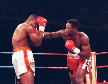 Dec 1992:  Lennox Lewis of Great Britain lands a punch on thejaw of Razor Ruddock during their non title fight in London England. Lewis won the fight with a T.K.O in the Second round.