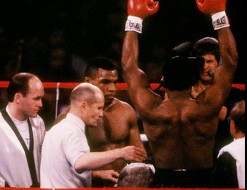 22 Nov 1986: Mike Tyson raises his arms in victory after a fight against Trevor Berbick in Las Vegas, Nevada. Tyson won the bout with a TKO in the second round.