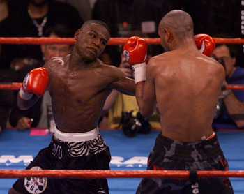 20 Jan 2001:  Floyd Mayweather, left, prepares to throw a right hand at Diego Corrales during their WBC Super Featherweight Championship bout at the MGM Grand Garden Arena in Las Vegas, Nevada.  DIGITAL IMAGE Mandatory Credit: Jeff Gross/ALLSPORT