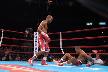 29 Sep 2001: Felix Trinidad sits on the canvas after being knocked  down by Bernard Hopkins at the end of their middleweight championship unification fight at Madison Square Garden in New York, New York. Hopkins won with a twelth round technical knockout.