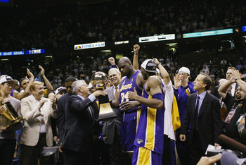 EAST RUTHERFORD, NJ - JUNE 12:  Shaquille O'Neal #34 of the Los Angeles Lakers is presented with the MVP trophy after defeating the New Jersey Nets in Game four of the 2002 NBA Finals on June 12, 2002 at Continental Airlines Arena in East Rutherford, New