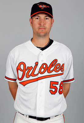 SARASOTA, FL - FEBRUARY 26:  Pitcher Justin Duchscherer #58 of the Baltimore Orioles poses for a photo during photo day at Ed Smith Stadium on February 26, 2011 in Sarasota, Florida.  (Photo by J. Meric/Getty Images)