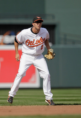 BALTIMORE, MD - APRIL 04: Shortstop J.J. Hardy #2 of the Baltimore Orioles against the Detroit Tigers during opening day at Oriole Park at Camden Yards on April 4, 2011 in Baltimore, Maryland.  (Photo by Rob Carr/Getty Images)