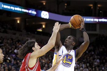 OAKLAND, CA - DECEMBER 20:  Ekpe Udoh #29 of the Golden State Warriors in action against the Houston Rockets at Oracle Arena on December 20, 2010 in Oakland, California. NOTE TO USER: User expressly acknowledges and agrees that, by downloading and or usin