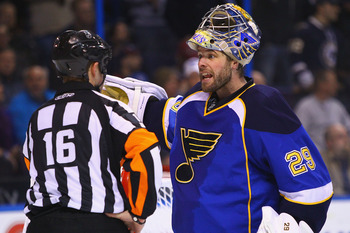 ST. LOUIS, MO - FEBRUARY 22: Ty Conklin #29 of the St. Louis Blues argues with an official over an uncalled penalty  while playing against the Colorado Avalanche at the Scottrade Center on February 22, 2011 in St. Louis, Missouri.  (Photo by Dilip Vishwan