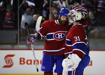 MONTREAL, CANADA - APRIL 26:  Paul Mara #22 of the Montreal Canadiens congratulates teammate Carey Price #31 on his victory over the Boston Bruins in Game Six of the Eastern Conference Quarterfinals during the 2011 NHL Stanley Cup Playoffs at the Bell Cen