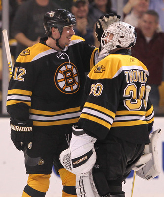 BOSTON, MA - APRIL 27:  Tomas Kaberle #12 of the Boston Bruins celebrates with goalie Tim Thomas #30 after defeating the Montreal Canadien in overtime of Game Seven of the Eastern Conference Quarterfinals during the 2011 NHL Stanley Cup Playoffs at TD Gar
