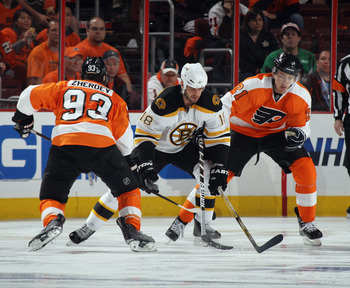 PHILADELPHIA, PA - APRIL 30: Nathan Horton #18 of the Boston Bruins carries the puck around Nikolay Zherdev #93 and James van Riemsdyk #21 of the Philadelphia Flyers in Game One of the Eastern Conference Semifinals during the 2011 NHL Stanley Cup Playoffs