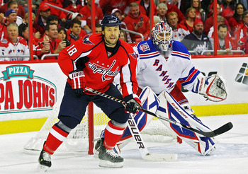 WASHINGTON , DC - APRIL 23: Marco Sturm #18 of the Washington Capitals skates in front of Henrik Lundqvist #30 of the New York Rangers in Game Five of the Eastern Conference Quarterfinals during the 2011 NHL Stanley Cup Playoffs at the Verizon Center on A