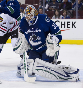 VANCOUVER, CANADA - APRIL 21: The puck flie over the shoulder of goalie Cory Schneider #35 of the Vancouver Canucks and wide of the net during the third period in Game Five of the Western Conference Quarterfinals against the Chicago Blackhawks during the