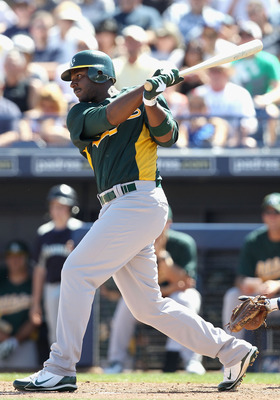 PEORIA, AZ - MARCH 12:  Chris Carter #22 of the Oakland Athletics hits a RBI single against the Seattle Mariners during the second inning of the spring training game at Peoria Stadium on March 12, 2011 in Peoria, Arizona.  (Photo by Christian Petersen/Get
