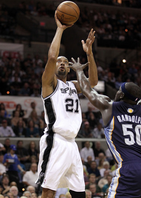 SAN ANTONIO, TX - APRIL 20:  Forward Tim Duncan  #21 of the San Antonio Spurs takes a shot against Zach Randolph #50 of the Memphis Grizzlies in Game Two of the Western Conference Quarterfinals in the 2011 NBA Playoffs on April 20, 2011 at AT&T Center in