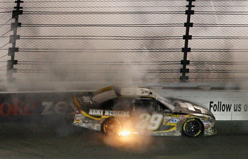 RICHMOND, VA - APRIL 30:  Ryan Newman, driver of the #39 U.S. Army Medicine Chevrolet, spins off of turn three during the NASCAR Sprint Cup Series Crown Royal Presents The Matthew & Daniel Hansen 400 at Richmond International Raceway on April 30, 2011 in