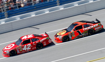 TALLADEGA, AL - APRIL 17:  Juan Pablo Montoya, driver of the #42 Target Chevrolet, leads Jamie McMurray, driver of the #1 Bass Pro Shops/Tracker Boats Chevrolet, during the NASCAR Sprint Cup Series Aaron's 499 at Talladega Superspeedway on April 17, 2011