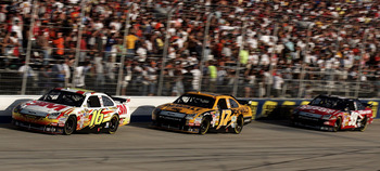 DOVER, DE - SEPTEMBER 21:  Greg Biffle, driver of the #16 3M Ford, leads teammates Matt Kenseth, driver of the #17 DeWalt Ford, and Carl Edwards, driver of the #99 Office Depot Ford, during the NASCAR Sprint Cup Series Camping World RV 400 at Dover Intern