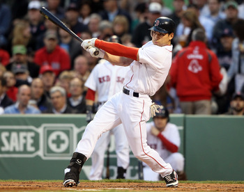 BOSTON, MA - MAY 02:  Jacoby Ellsbury #2 of the Boston Red Sox hits a single in the first inning against the Los Angeles Angels on May 2, 2011 at Fenway Park in Boston, Massachusetts.  (Photo by Elsa/Getty Images)