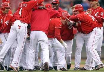 CINCINNATI, OH - MAY 04:  Jay Bruce #32 of the Cincinnati Reds celebrates with teammates after driving in the winning run in the Reds 3-2 victory over the Houston Astros at Great American Ball Park on May 4, 2011 in Cincinnati, Ohio.  (Photo by Andy Lyons