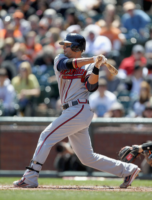 SAN FRANCISCO, CA - APRIL 24:  Martin Prado #14 of the Atlanta Braves in action against the San Francisco Giants at AT&T Park on April 24, 2011 in San Francisco, California.  (Photo by Ezra Shaw/Getty Images)