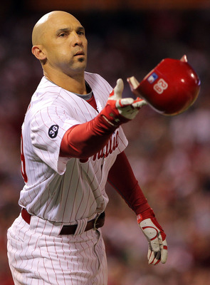 PHILADELPHIA - OCTOBER 17:  Raul Ibanez #29 of the Philadelphia Phillies throws his helmet from first base in the seventh inning against the San Francisco Giants in Game Two of the NLCS during the 2010 MLB Playoffs at Citizens Bank Park on October 17, 201