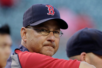BALTIMORE, MD - APRIL 26: Manager Terry Francona #47 of the Boston Red Sox watches as his team take batting practice before the start of a game against the Baltimore Orioles at Oriole Park at Camden Yards on April 26, 2011 in Baltimore, Maryland.  (Photo