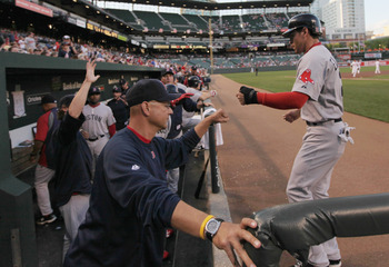 BALTIMORE, MD - APRIL 28:  Manager Terry Francona (L) congratulates Jacoby Ellsbury #2 of the Boston Red Sox (R) after he scored against the Baltimore Orioles during the first inning at Oriole Park at Camden Yards on April 28, 2011 in Baltimore, Maryland.
