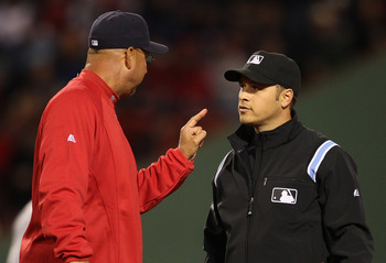 BOSTON, MA - APRIL 10:  Manager Terry Francona of the Boston Red Sox disagrees with the call of second base umpire Mark Wegner at second during a game against the New York Yankees at Fenway Park April 10, 2011 in Boston, Massachusetts. (Photo by Jim Rogas