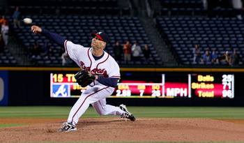 ATLANTA, GA - MAY 04:  Tim Hudson #15 of the Atlanta Braves pitches in the ninth inning against the Milwaukee Brewers at Turner Field on May 4, 2011 in Atlanta, Georgia.  (Photo by Kevin C. Cox/Getty Images)