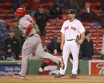 BOSTON, MA - MAY 4: Vernon Wells #10 of the Los Angeles Angels hits a two-run home run against the Boston Red Sox at Fenway Park on May 4, 2011 in Boston, Massachusetts. (Photo by Jim Rogash/Getty Images)
