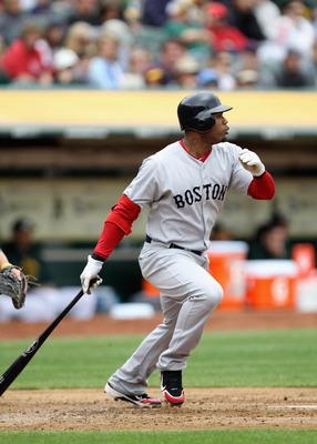OAKLAND, CA - APRIL 20:  Carl Crawford #13 of the Boston Red Sox hits an RBI single that scored Kevin Youkilis #20 during their game against the Oakland Athletics at Oakland-Alameda County Coliseum on April 20, 2011 in Oakland, California.  (Photo by Ezra