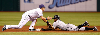 ST. PETERSBURG, FL - APRIL 21:  Infielder Ben Zobrist #18 of the Tampa Bay Rays is late with the tag as outfielder Juan Pierre #1 of the Chicago White Sox steals second base during the game at Tropicana Field on April 21, 2011 in St. Petersburg, Florida.
