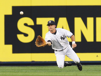 NEW YORK - JUNE 18:  Brett Gardner #11 of the New York Yankees makes a catch against the New York Mets on June 18, 2010 at Yankee Stadium in the Bronx borough of New York City.  (Photo by Al Bello/Getty Images)
