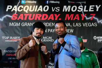 NEW YORK, NY - FEBRUARY 14:  (L) Manny Pacquiao and (R) Shane Mosley pose to promote their upcoming fight at The Lighthouse at Chelsea Piers on February 14, 2011 in New York City.  (Photo by Chris Trotman/Getty Images)