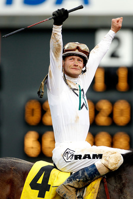 LOUISVILLE, KY - MAY 01:  Calvin Borel celebrates atop Super Saver after winning the 136th running of the Kentucky Derby on May 1, 2010 in Louisville, Kentucky.  (Photo by Matthew Stockman/Getty Images)