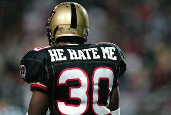 3 Feb 2001:  A rear view of Rod Smart #30 of the Las Vegas Outlaws walking on the field during the game against the New York/New Jersey Hitmen at the Sam Boyd Stadium in Las Vegas, Nevada.  The Outlaws defeated the Hitmen 19-0.Mandatory Credit: Todd Warsh