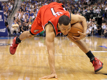 DALLAS, TX - APRIL 16:  Guard Brandon Roy #1 of the Portland Trail Blazers loses his balance in Game One of the Western Conference Quarterfinals during the 2011 NBA Playoffs on April 16, 2011 at American Airlines Center in Dallas, Texas.  NOTE TO USER: Us