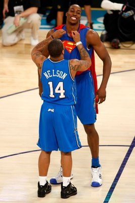 NEW ORLEANS - FEBRUARY 16:  Dwight Howard of the Orlando Magic gets help from teammate Jameer Nelson to put on a Superman costume for Howard's second dunk of the Sprite Slam Dunk Contest, part of 2008 NBA All-Star Weekend at the New Orleans Arena on Febru