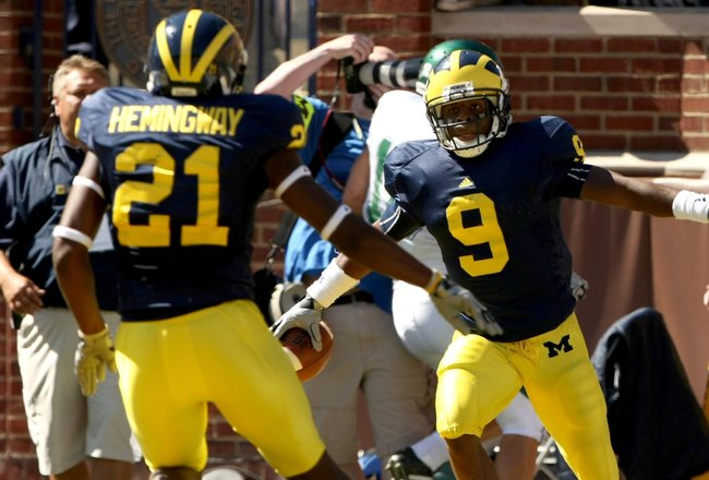 ANN ARBOR, MI - SEPTEMBER 19:  Receiver Martavious Odoms #9 of the Michigan Wolverines celebrates his touchdown with Junior Hemingway #21 in the game with the Eastern Michigan Eagles at Michigan Stadium on September 19, 2009 in Ann Arbor, Michigan. (Photo