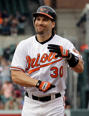 BALTIMORE, MD - APRIL 10: Luke Scott #30 of the Baltimore Orioles reacts after flying out to end the eighth inning against the Texas Rangers at Oriole Park at Camden Yards on April 10, 2011 in Baltimore, Maryland.  (Photo by Rob Carr/Getty Images)