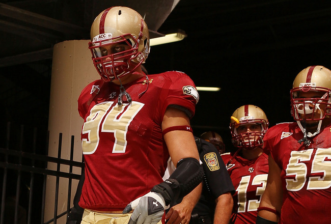CHESTNUT HILL, MA - SEPTEMBER 04:  Mark Herzlich #94, Damik Scafe #55 and Codi Boek #13 of the Boston College Eagles walk out to the field for the home opening game against the Weber State Wildcats on September 4, 2010 at Alumni Stadium in Chestnut Hill,