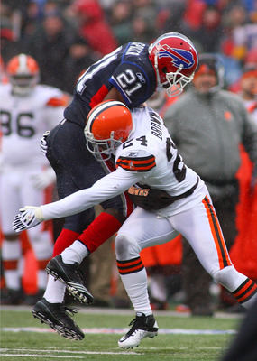 ORCHARD PARK, NY - DECEMBER 12: C.J. Spiller #21 of the Buffalo Bills is tackled by Sheldon Brown #24 of the Cleveland Browns  at Ralph Wilson Stadium on December 12, 2010 in Orchard Park, New York.  Buffalo won 13-6.(Photo by Rick Stewart/Getty Images)