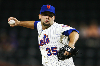 NEW YORK - SEPTEMBER 30:  Dillon Gee #35 of the New York Mets pitches against the Milwaukee Brewers during their game on September 30, 2010 at Citi Field in the Flushing neighborhood of the Queens borough of New York City.  (Photo by Andrew Burton/Getty I