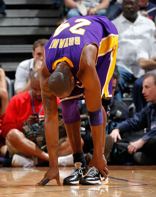ATLANTA - MARCH 31:  Kobe Bryant #24 of the Los Angeles Lakers grabs his left ankle after attacking the basket against the Atlanta Hawks at Philips Arena on March 31, 2010 in Atlanta, Georgia.  NOTE TO USER: User expressly acknowledges and agrees that, by