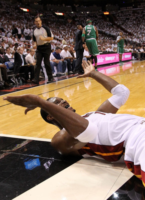 MIAMI, FL - MAY 03: Chris Bosh #1 of the Miami Heat reacts to  a foul during Game Two of the Eastern Conference Semifinals of the 2011 NBA Playoffs against the Boston Celtics at American Airlines Arena on May 3, 2011 in Miami, Florida. NOTE TO USER: User