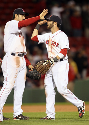 BOSTON, MA - MAY 02:  Adrian Gonzalez #28 and Dustin Pedroia #15 of the Boston Red Sox celebrate the win over the Los Angeles Angels on May 2, 2011 at Fenway Park in Boston, Massachusetts. The Boston Red Sox defeated the Los Angeles Angels 9-5.  (Photo by