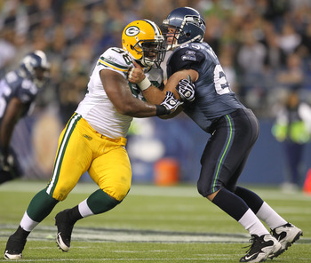 SEATTLE - AUGUST 21:  Defensive end C.J. Wilson #98 of the Green Bay Packers battles Jeff Byers #63 during the preseason game against the Seattle Seahawks at Qwest Field on August 21, 2010 in Seattle, Washington. (Photo by Otto Greule Jr/Getty Images)