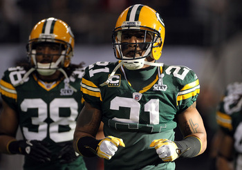 ARLINGTON, TX - FEBRUARY 06:  Tramon Williams #38 and Charles Woodson #21 of the Green Bay Packers warm up before taking on the Pittsburgh Steelers in Super Bowl XLV at Cowboys Stadium on February 6, 2011 in Arlington, Texas.  (Photo by Doug Pensinger/Get